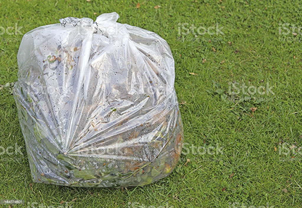 garden waste in recyclable bag royalty-free stock photo