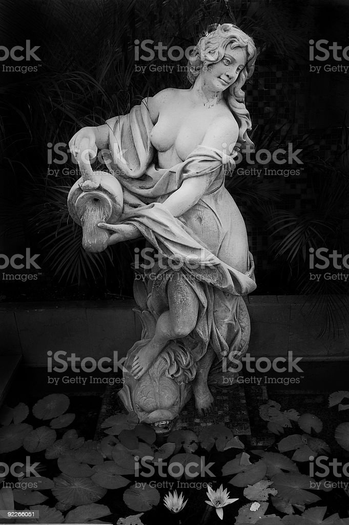 Garden with female statue royalty-free stock photo
