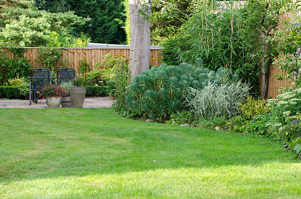 Garden with patio area, lawn and flowerbeds. - Photo