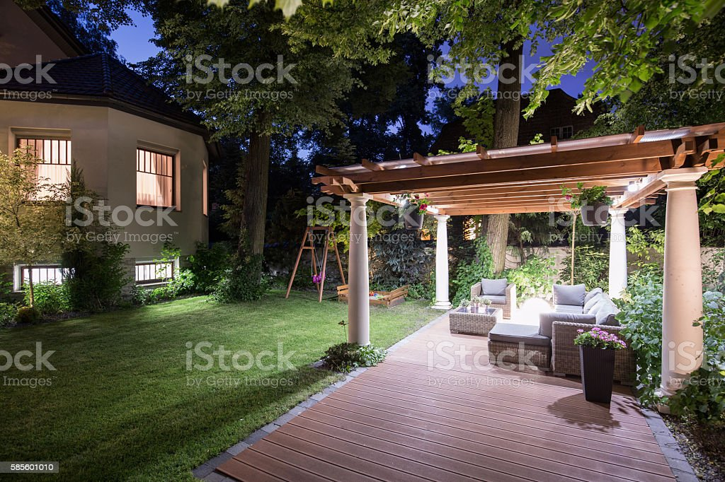 Garden with patio at night stock photo