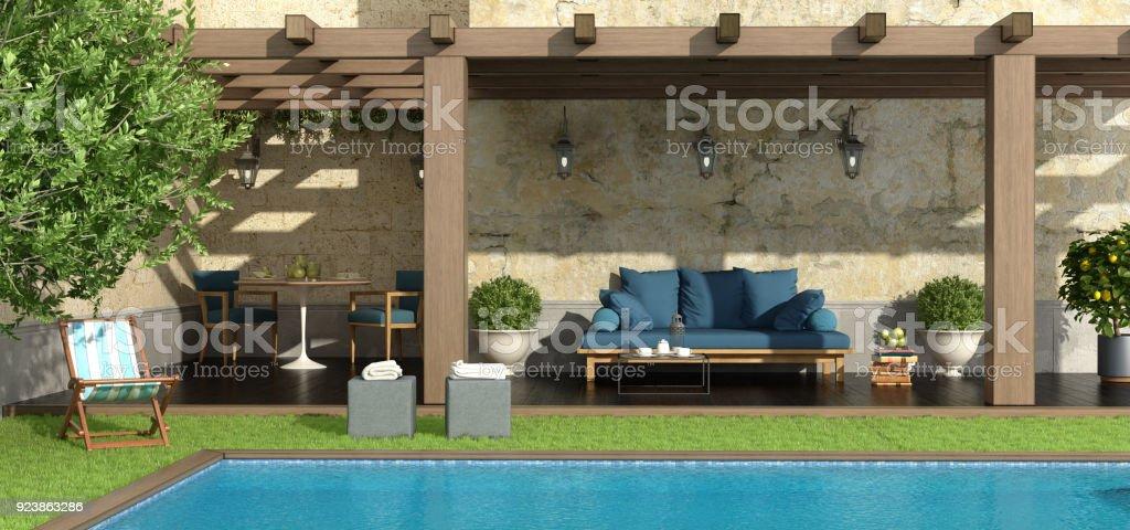Garden with pergola and pool stock photo