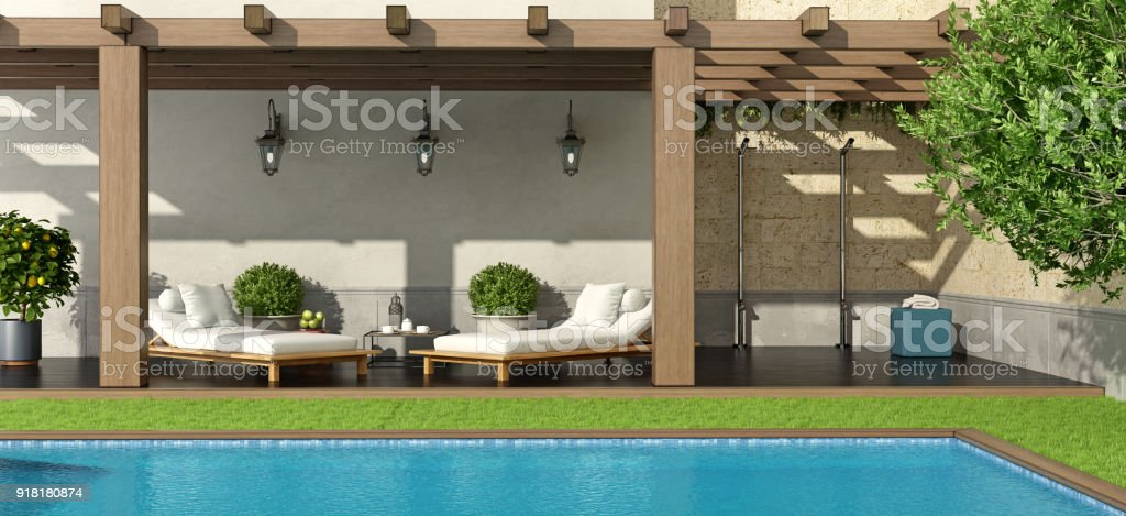 Garden with pergola and swimming pool stock photo