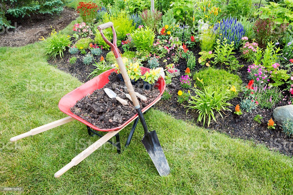 Garden work being done landscaping a flowerbed stock photo