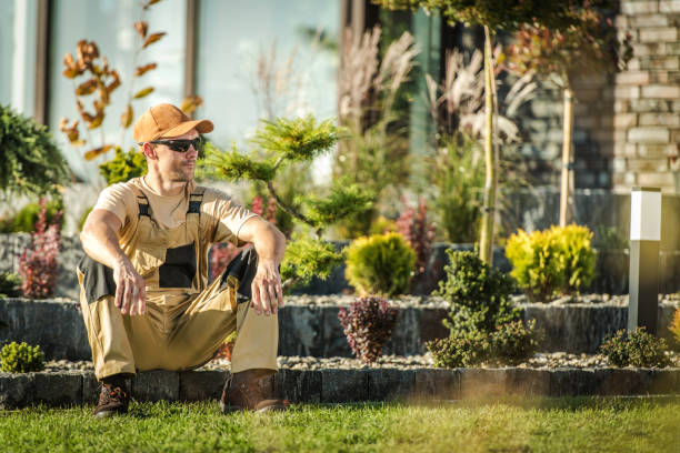 Gardener Sitting Down And Taking Break At Work. stock photo