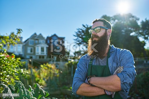 istock gardener with beard in urban communal garden 599700694