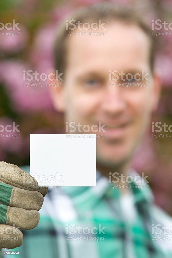Gardener with businesscard, copyspace royalty-free stock photo