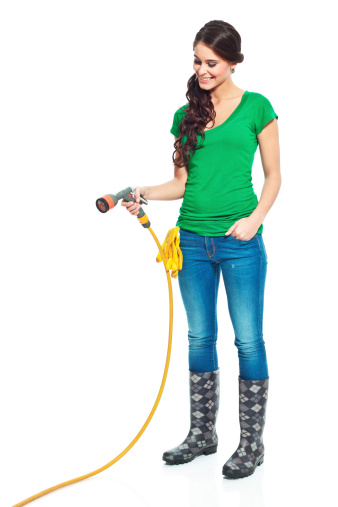 Gardener With Garden Hose Stock Photo - Download Image Now