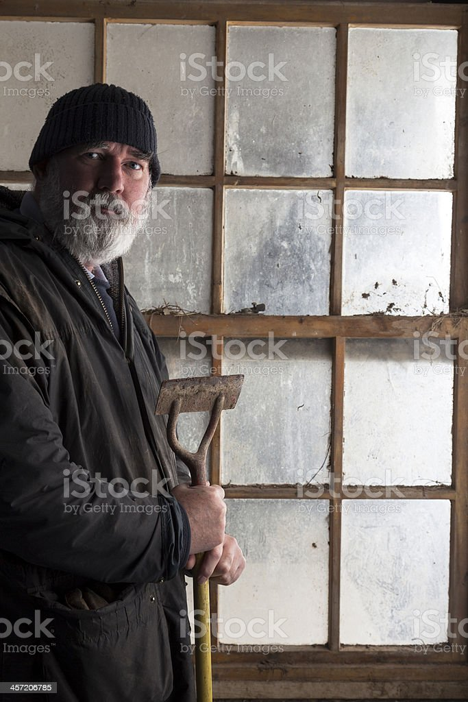 Gardener With His Hoe royalty-free stock photo