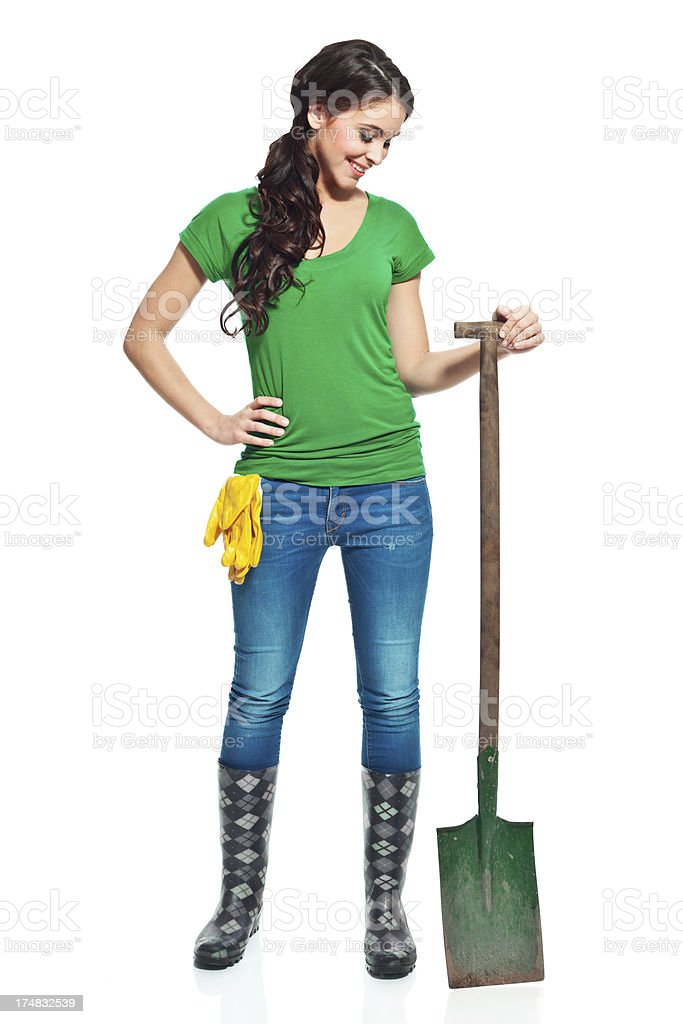 Gardener with spade Full lenght portrait of beautiful gardener standing with a spade. 20-24 Years Stock Photo