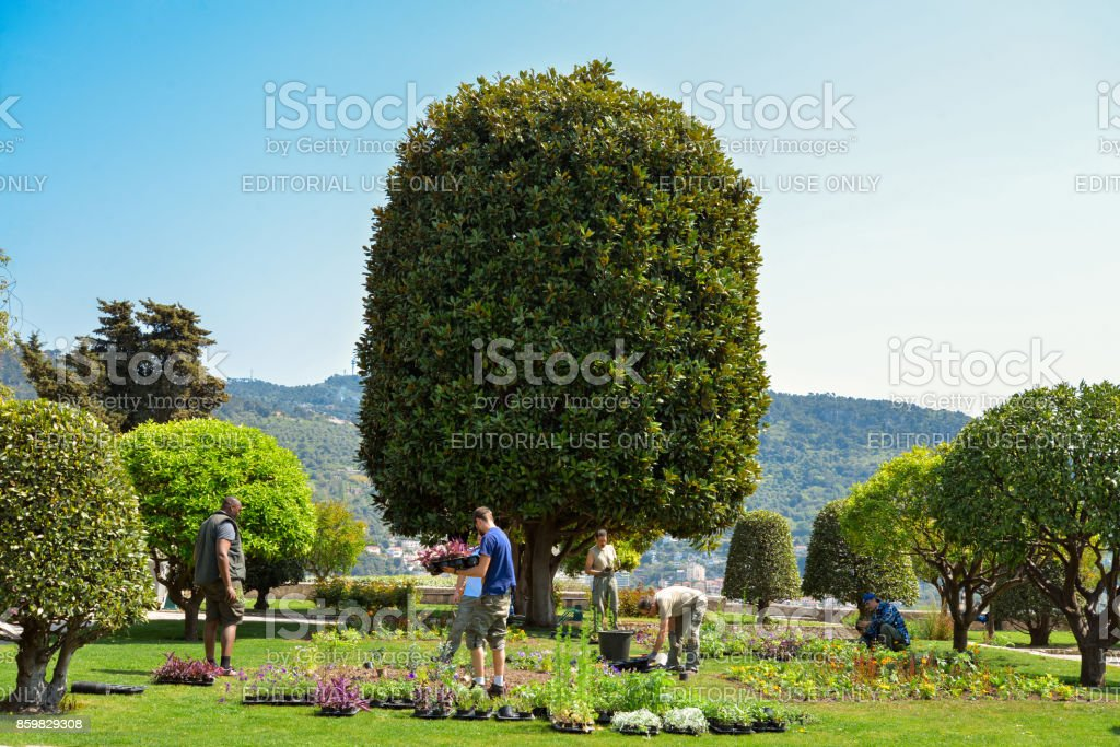 Gardeners working at garden Franciscan monastery stock photo