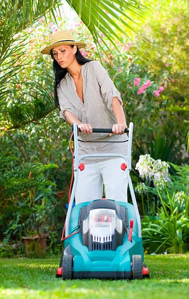 gardening mowing woman stock photo