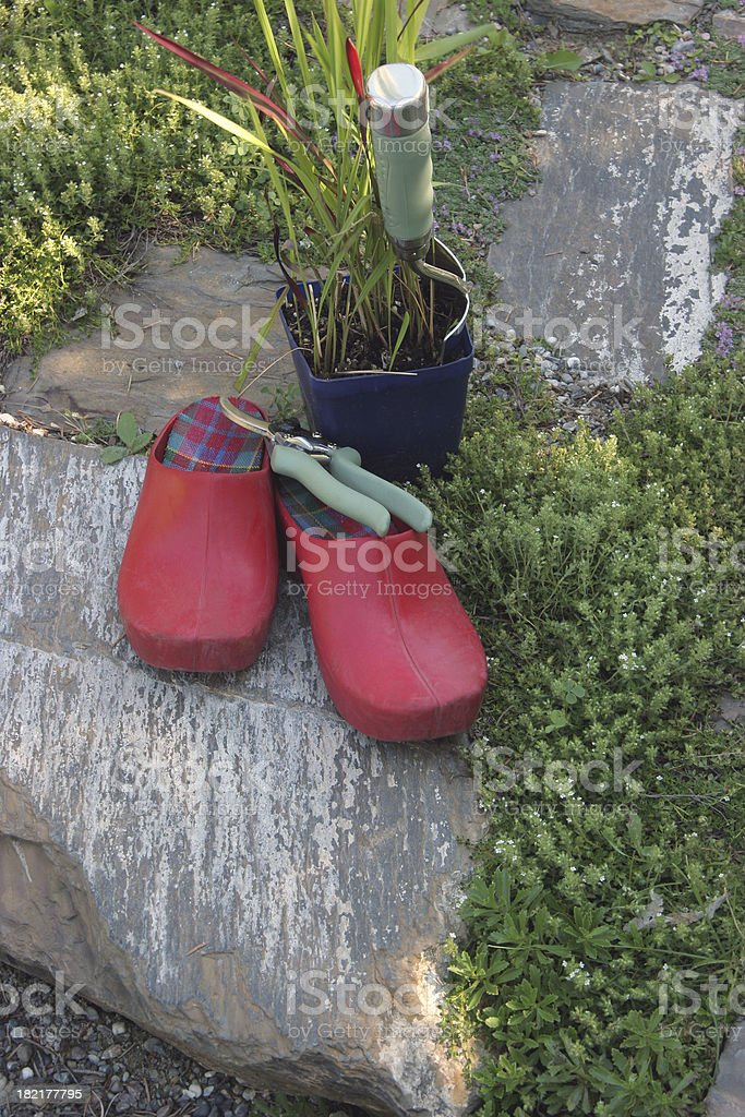 Gardening Shoes,Trowel, and Pruning Shears royalty-free stock photo
