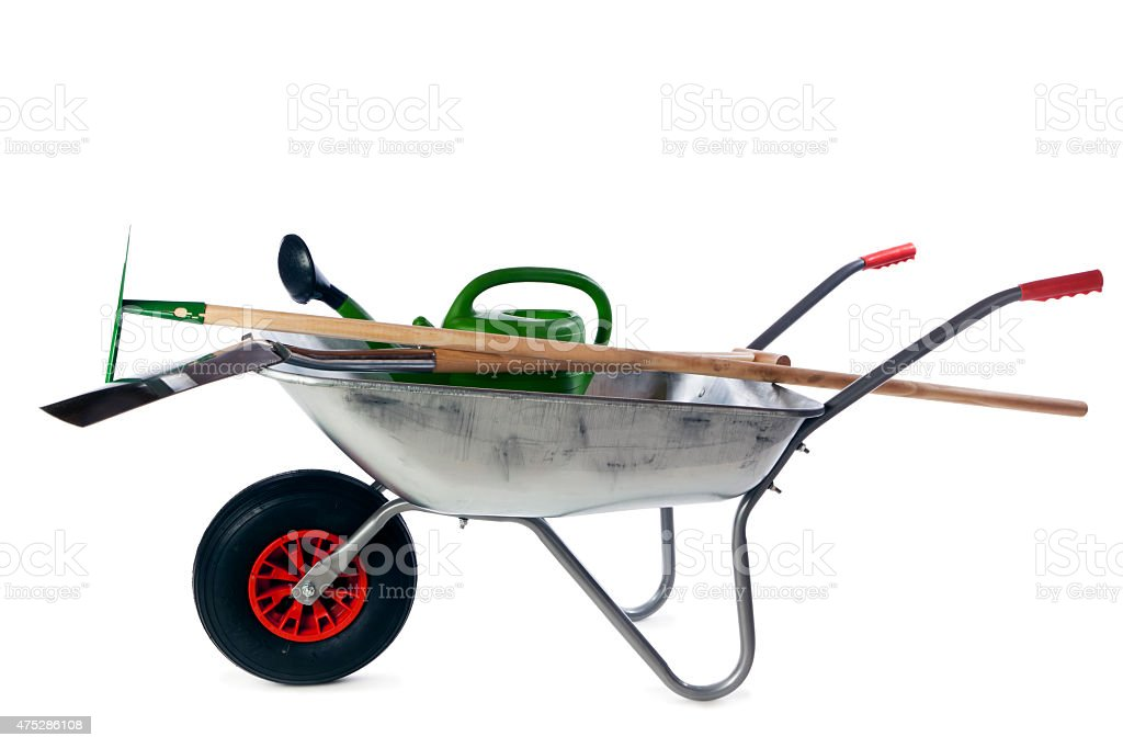 Gardening tools in wheelbarrow isolated stock photo