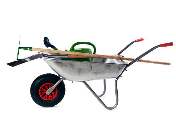 gardening tools in wheelbarrow isolated - kruiwagen met gereedschap stockfoto's en -beelden