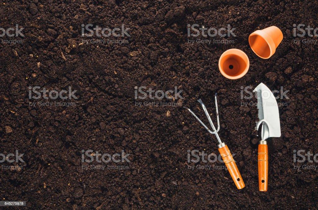 Gardening tools on garden soil texture background top view stock photo