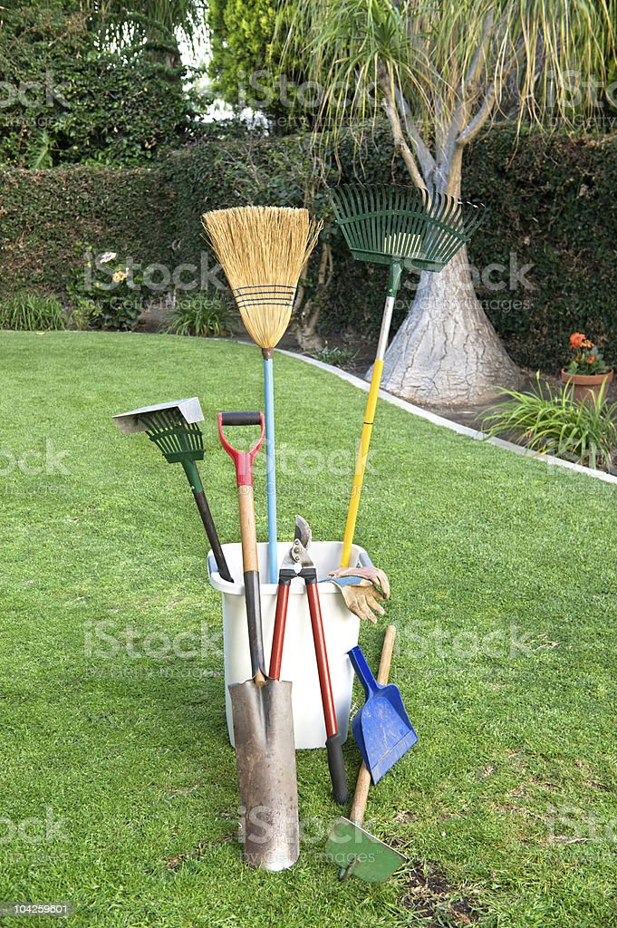 Gardening tools on grass royalty-free stock photo