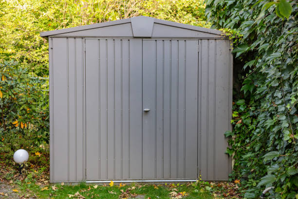 Gardening tools storage shed in the house backyard Gardening tools storage shed in the house backyard, autumn nature background shed stock pictures, royalty-free photos & images