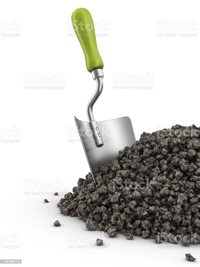 gardening trowel in dirt heap royalty-free stock photo