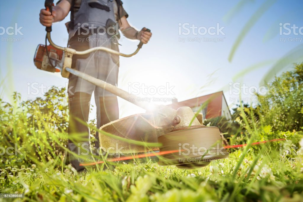 Gardening with a brushcutter stock photo