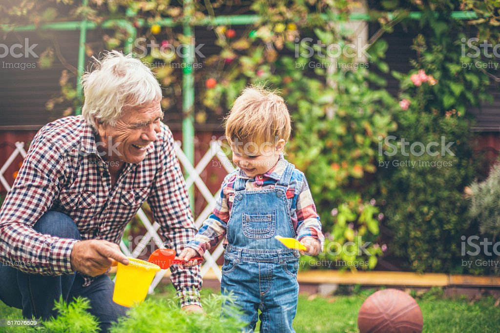 Gardening with my grandson stock photo