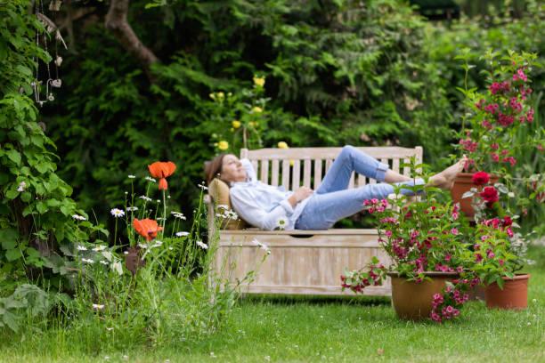 Gardening - Woman enjoy relaxing in the garden stock photo