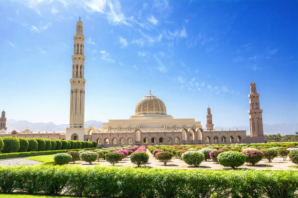 Gardens and the Muscat Grand Mosque (Oman) Gardens and the Muscat Grand Mosque (Oman) grand mosque stock pictures, royalty-free photos & images