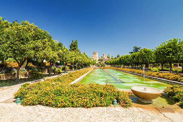Gardens of Alcazar, Cordoba, Andalusia province, Spain Fountain and gardens of Alcazar de los Reyes Cristianos, Cordoba, Andalusia province, Spain alcazar palace stock pictures, royalty-free photos & images