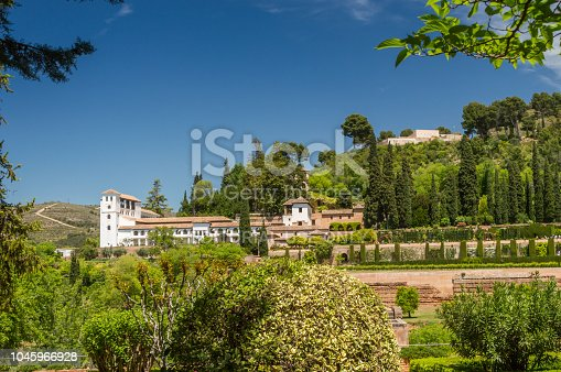 121178604 istock photo Gardens of the Alhambra with Generalife (summer palace) in the distance 1045966928