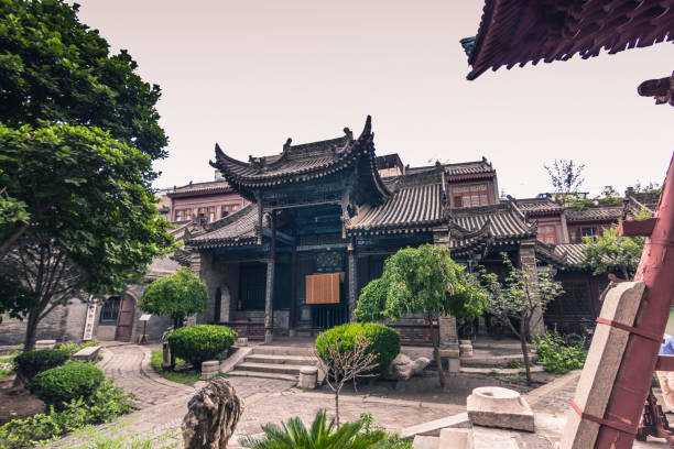 Xi'an, China - July 23, 2014: Gardens of the Great Mosque of Xi'an Xi'an, China - July 23, 2014: Gardens of the Great Mosque of Xi'an grand mosque stock pictures, royalty-free photos & images