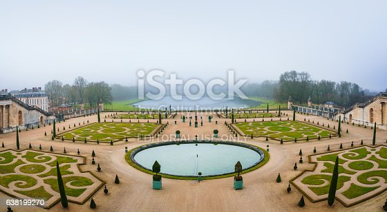 Paris, France - January 7, 2016: Gardens of Versailles Apollo Fountain. Versailles was a hunting lodge until King Louis XVI transformed it into a palace during the 17th century.