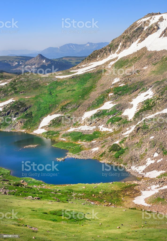 Gardner Lake, Beartooth Pass. Peaks of Beartooth Mountains, Shoshone National Forest, Wyoming, USA. Vertical layout. stock photo