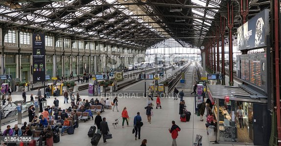 Paris, France - September 19, 2013: A large number of passengers waiting for trains at the Gare de Lyon Station.