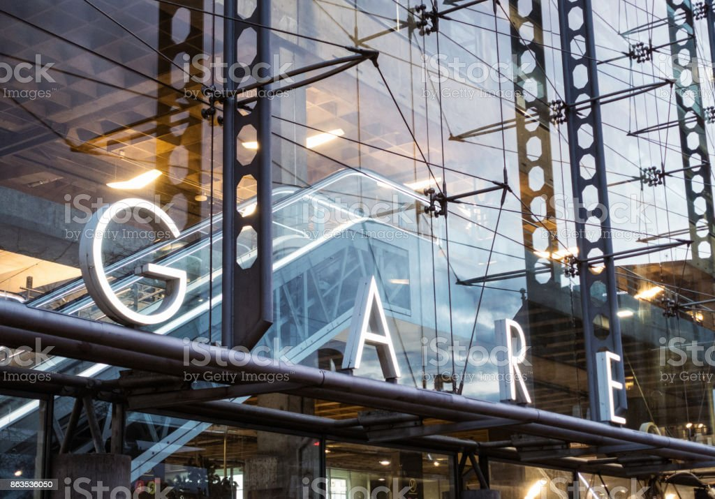 Gare sign - modern train station in Paris A sign for Gare ('train station in French') on a modern station in the Montparnasse district of Paris. Architecture Stock Photo