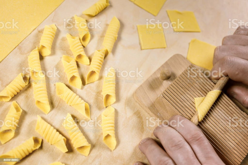 Garganelli, a kind of special homemade macaroni, at the end of preparation process. stock photo