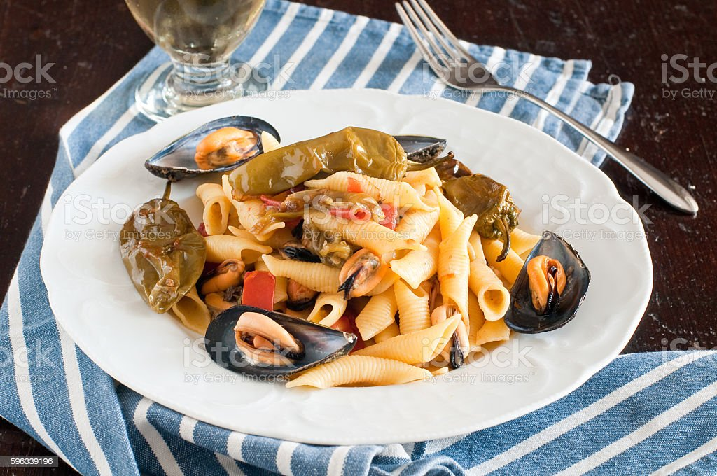 Garganelli , typical Italian pasta of the Veneto , with mussels royalty-free stock photo
