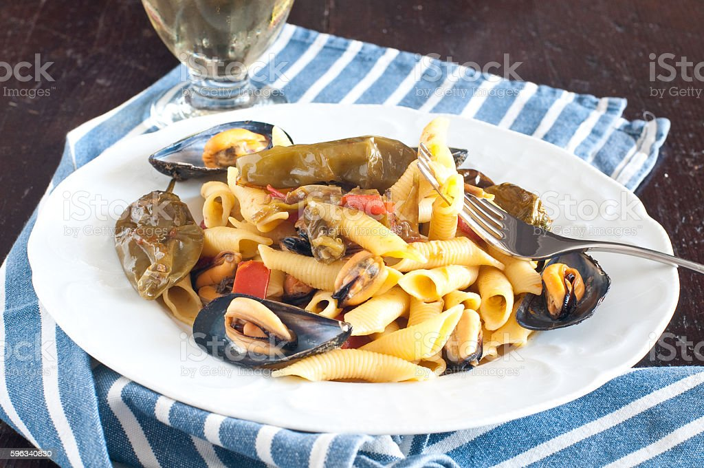Garganelli , typical Italian pasta of the Veneto with mussels royalty-free stock photo