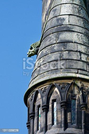 istock Gargoyle and tower 1311339226