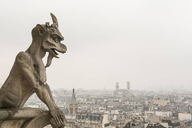 gargoyle at notre dame - demon stock photos and pictures