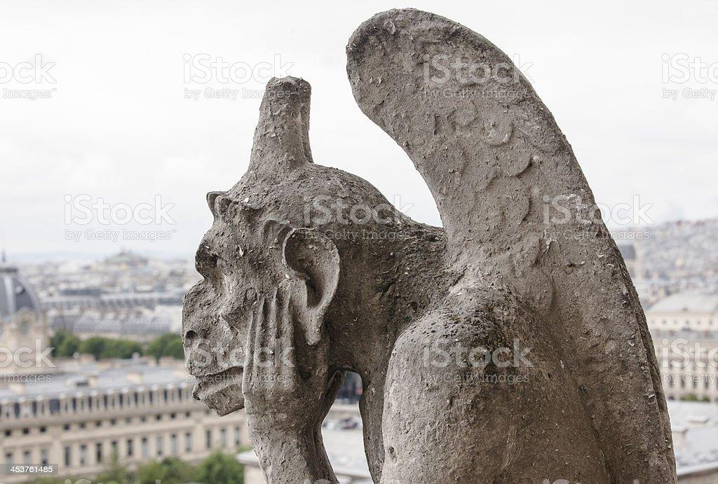 Gargoyle on Notre Dame Cathedral Paris royalty-free stock photo