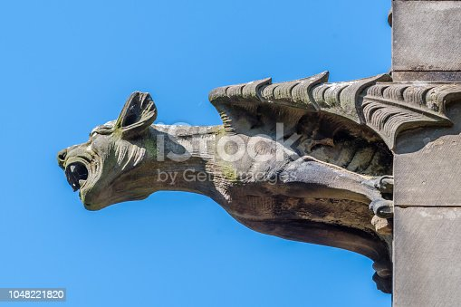 Gargoyle on side of a Building