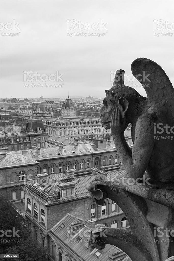 Gargoyle overlooking Paris royalty-free stock photo