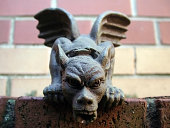 Gargoyles on the east end of York Minster.  The column sits beside the famous stained-glass Great East Window.