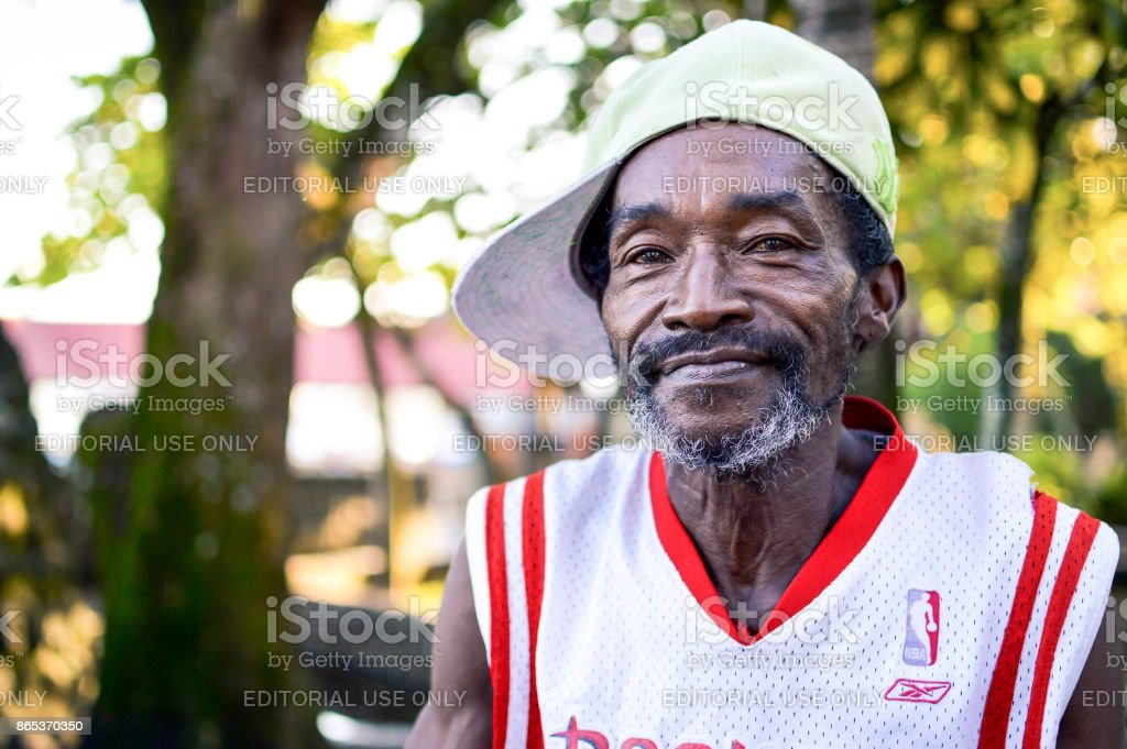 Garifuna man smiles into the camera on March 7, 2015 in Livingston, Guatemala stock photo