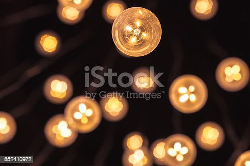 istock Garland of bulb lamps with modern yellow LED 852410972