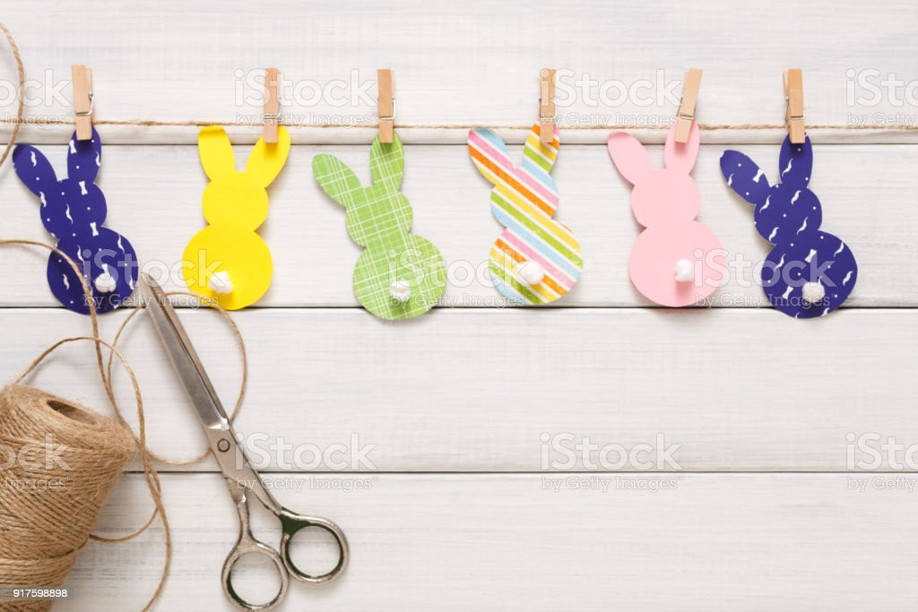 Garland with easter bunnies on white wood background, copy space stock photo