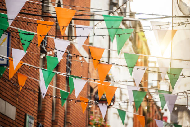 Garland with irish flag colors in a street of Dublin, Ireland - Saint Patrick day celebration concept stock photo
