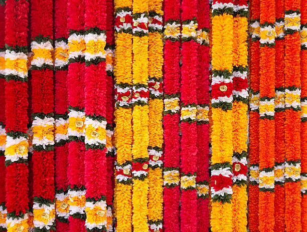 garlands of red and yellow flowers. - indische blumen stock-fotos und bilder