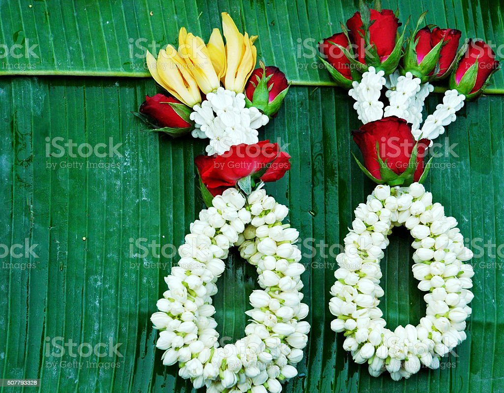 Garlands with jasmine and roses at thai flower market stock photo garlands with jasmine and roses at thai flower market royalty free stock photo izmirmasajfo