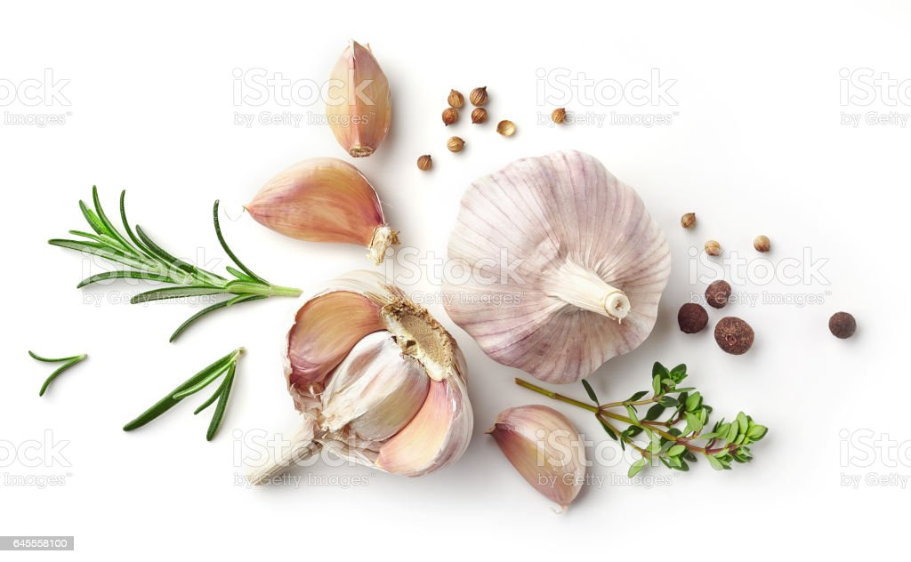 garlic and herbs isolated on white - foto stock