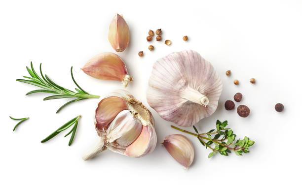 garlic and herbs isolated on white - garlic stock photos and pictures